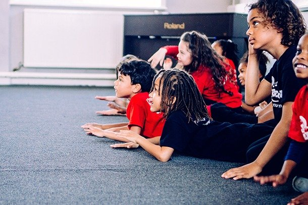 Children take part in a performing arts class run by Cherry Stars