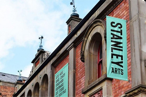Modern building frontage showing Stanley Arts banners