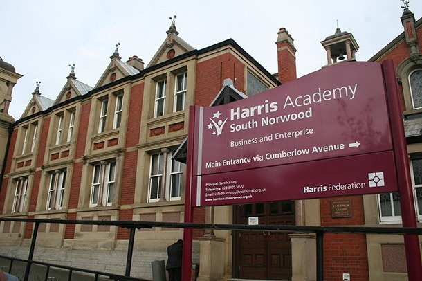 A modern photograph of the Harris Academy sign in front of the former Stanley Technical School Building